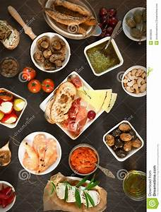 Wide Variety Tapas On Brown Table Stock Image - Image of