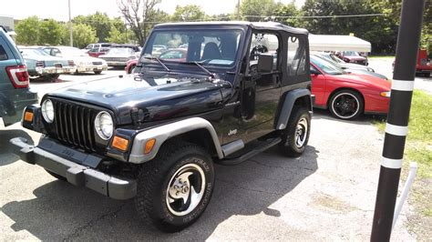 dark gray jeep wrangler 2 door black originally yellow dark grey cloth interior 4 0