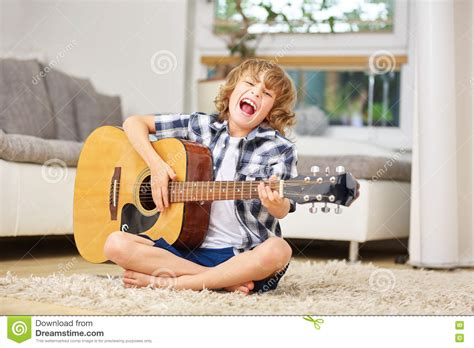 Parents have their own page for event news, encouragement, and additional resources. Boy Having Fun Making Music With Guitar Stock Photo - Image of friends, play: 81155714