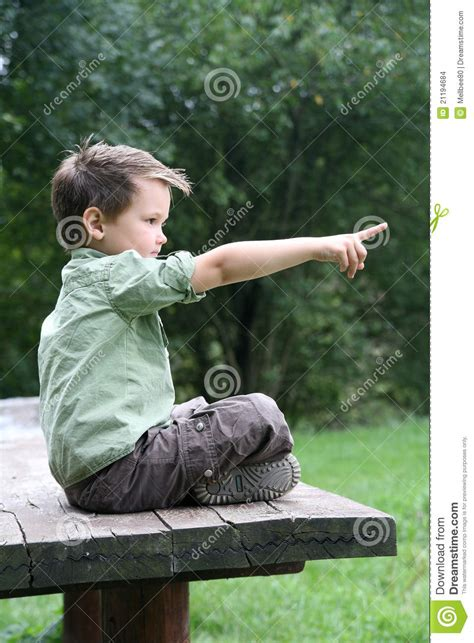boy cross legged   wooden bench stock images image
