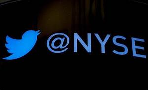 The Twitter logo is displayed ahead of the company's IPO on the floor of the New York Stock ...