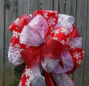 christmas bows lighted christmas trees and christmas tree toppers on pinterest