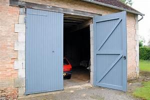 Porte de garage hauteur requise for Grande porte garage