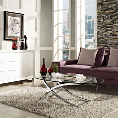 This particular coffee table is a very popular choice for the people because of its amazing metal design that will go great with the stylish look of the living room. MODERN CHROME AND CLEAR OVAL GLASS COFFEE TABLE SOLO - Modern - Coffee Tables - San Francisco ...
