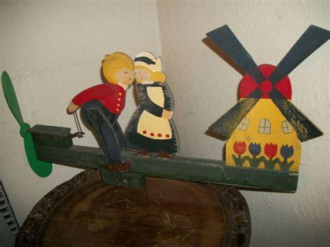 vintage whirligig dutch windmill  boy kissing