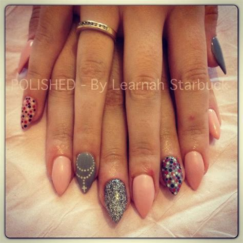gray pin dot my anywhere pink grey stiletto nails with rosary glitter