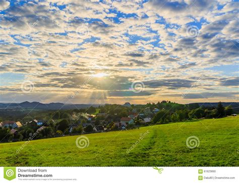 Beautiful Sunset Over Countryside Landscape Of Rolling