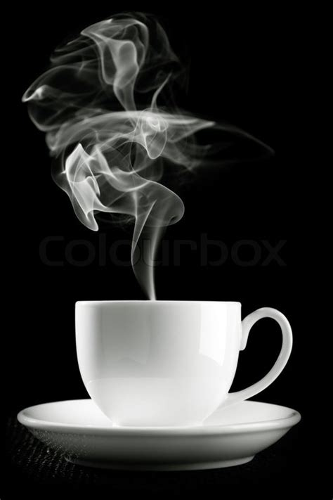 Coffee cup over the table against black background   Stock Photo   Colourbox