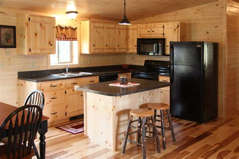 unstained wooden kitchen cabinet using black countertop