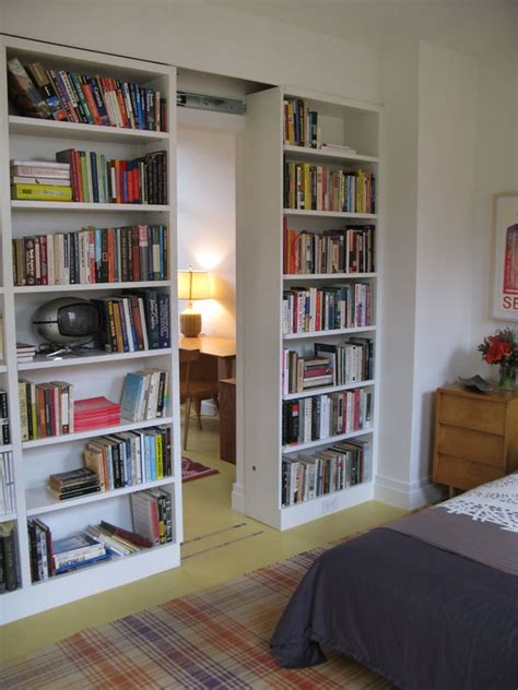 Bookshelves As Room Focus by Sliding Bookshelves Room Divider To Hide Basement Storage