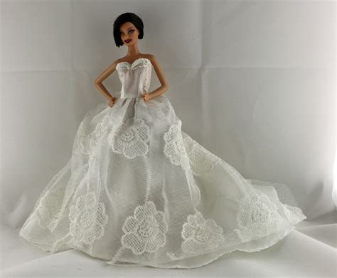 White Floral Wedding Dress With A Long Train With Veil And