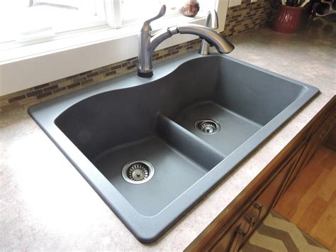 top mount farmhouse kitchen sink on brown granite