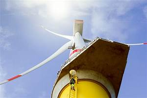 Manual High Worker Climbing On Biggest Windturbine Stock