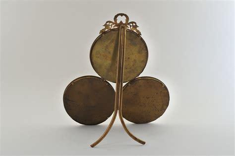 Legge Cornice Cornice Antica In Bronzo Dorato Con 3 Portaritratti Circolari