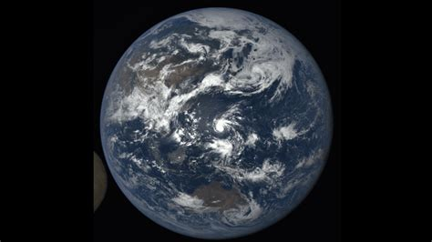 wtsp.com | Photobomb! Satellite catches moon crossing ...