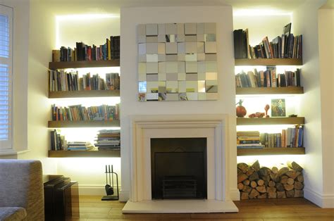 living room bookshelves and cabinets exposed brick wall surround fireplace wit white mantel