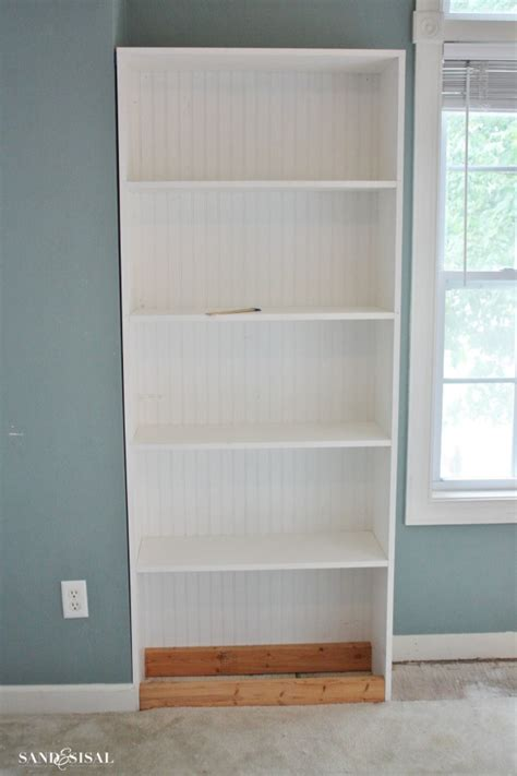 how to secure bookcase to wall diy built in bookshelves window seat sand and sisal