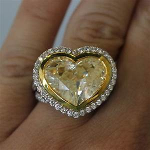 18k two tone gold 832ct heart shaped fancy yellow diamond With yellow diamond wedding ring