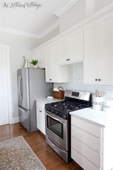 gray owl kitchen cabinets cottage style kitchen update the lettered cottage 235 | The Lettered Cottage Kitchen Cabinets are Simply White Walls are Gray Owl lightened by 50 percent Backsplash from Caledonia Stone and Tile