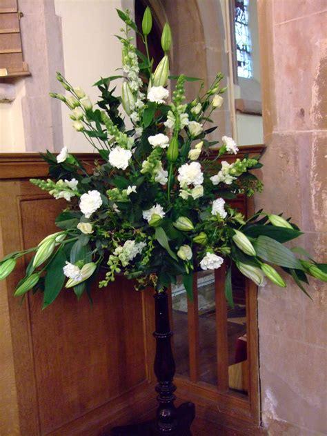 pedestals floral decorators instagram large flower arrangements for church church flowers in