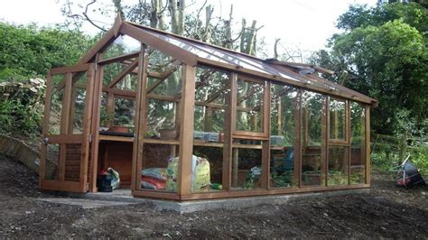 inspiring wood house construction photo brown wooden house frame with glass wall on the tree of