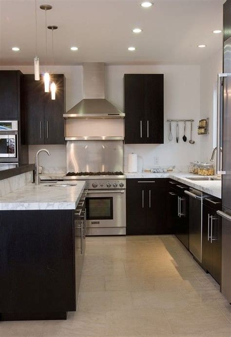 dark cabinets white counters stainless steel appliances