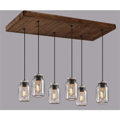installer un comptoir de cuisine luminaire éaire suspendu sur base en bois avec pots