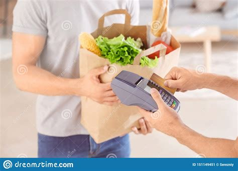 If you stop using these credit cards, you'll never run the risk of a credit card balance. Man Taking Off Money For Food Delivery From Client S Credit Card Using Bank Terminal Stock Image ...