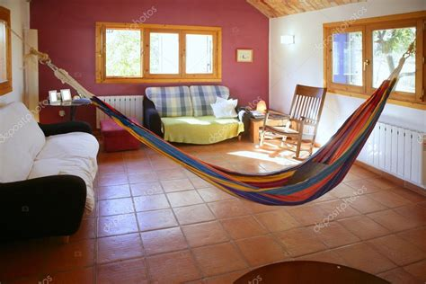 living room  warm colors mexican hammock stock photo