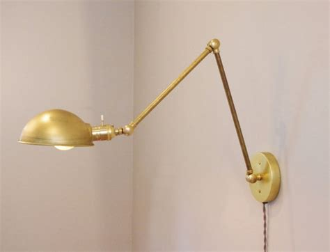 industrial articulating brass wall l with parabolic shade