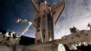 Shuttle Discovery docks with space station for 13th and ...