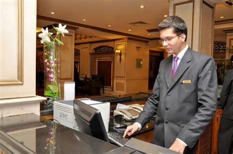 hotel front desk system hotel management trainee working at the front desk at the