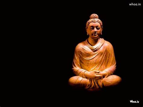 lord gautama buddha  dark background wallpaper