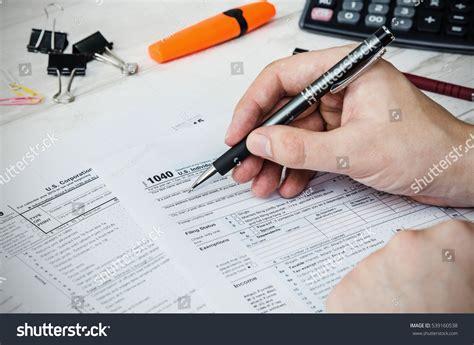 Man Filling Us Tax Form Tax Stock Photo 539160538