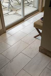 The pros and cons of marble tile diy for Marble bathroom tiles pros and cons