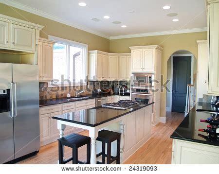 white kitchen cabinets black granite countertops modern kitchen white cabinets black granite stock photo 2055