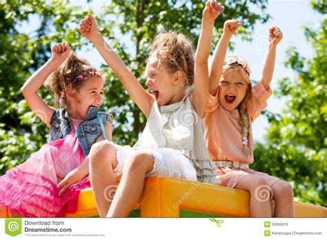 Young Girls Shouting And Raising Arms Outdoors Royalty