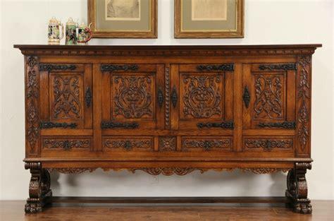 sold spanish hand carved oak  antique signed