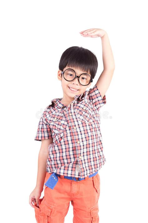 12919 photography style boy in studio asian boy growing and measuring himself stock photo