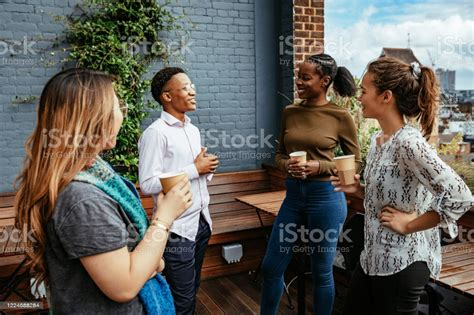 How to prepare for your trip. Group Of Diverse Millennials Drinking Coffee And Chatting Stock Photo - Download Image Now - iStock
