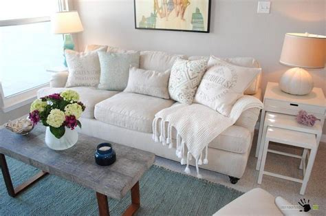 pillows for living room sofa comfort white sofa with small pillows and blanket in a