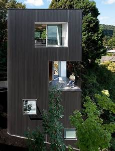 Modern, Vertical, House, Accessed, By, A, Steel, Pedestrian, Bridge
