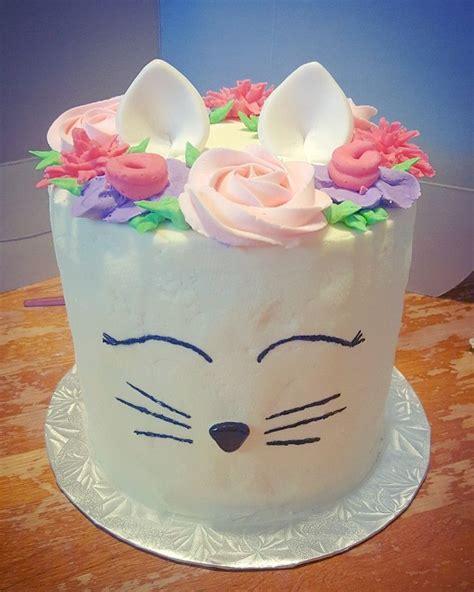 A cat celebrates a birthday. 6 layer rainbow cat cake | Cat cake, Cake decorating, Cake