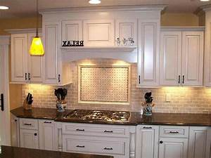 backsplash ideas with white cabinets and dark countertops 628