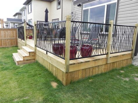 bent railing design on a custom outdoor deck modern