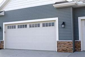 Madison window inserts in almond carriage style garage for Carriage type garage doors
