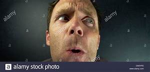 The head of a scared Man hiding from someone Stock Photo ...