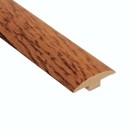 home depot t molding home legend oak gunstock 1 4 in thick x 1 3 8 in wide x 94 1 2 in length vinyl t molding
