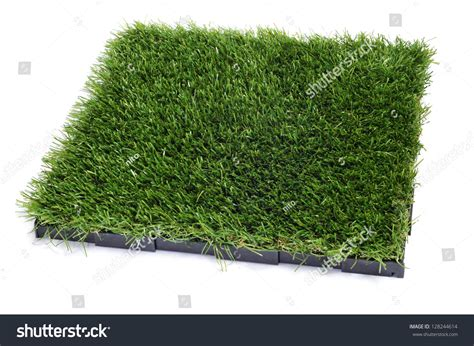artificial turf tile on a white background stock photo