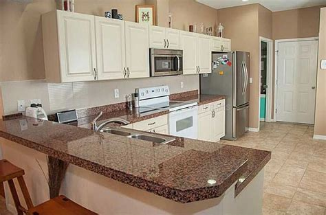 brown cabinets with white countertops tan brown granite countertops pictures cost pros and cons